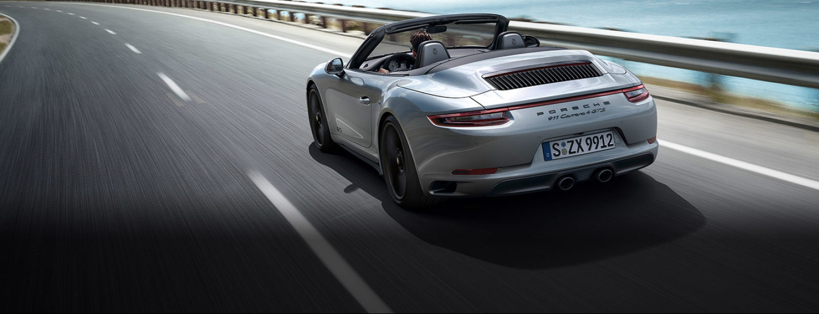 Porsche - 911 Carrera 4 GTS Cabriolet - Driven for more.